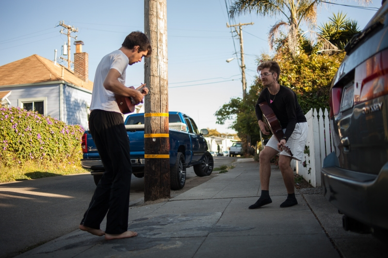 Ethan and Sam playing a tune on the street.