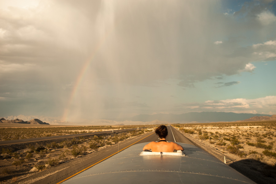 Rainstorm and rainbows provide a chance to cool off in the NV desert.